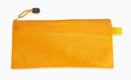 Ein orange Bleistiftkasten auf weißem Hintergrund Lizenzfreies Stockbild