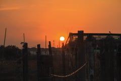 Ein orange Sonnenuntergang Lizenzfreies Stockbild