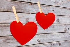 Ein Paar Herzen verdübelte auf einer Linie vektor abbildung