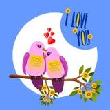 Ein Paar leidenschaftliche und gemütliche Vögel auf geblühter Niederlassung lizenzfreie stockbilder