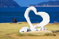 Ein Paar mit dem Herzen wenden am Kap Hado in Karatsu, Japan ein Stockfotos
