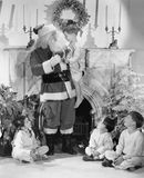 Ein persönlicher Besuch von Santa Claus (alle dargestellten Personen sind nicht längeres lebendes und kein Zustand existiert Lief Stockfotos
