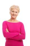 Ein Porträt alter Dame in der rosa zufälligen Kleidung. lizenzfreie stockbilder