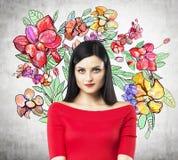 Ein Porträt eines nachdenklichen Brunette in einem roten Kleid stock abbildung