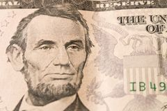 Ein Porträt von Präsidenten Abraham Lincoln auf 5 Dollarschein abschluß stockbilder