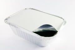 Ein quadratisches geöffnetes bietendes Tellersegment der Folie teils Stockfotos