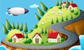 Ein Raumschiff und ein Dorf Stockfoto