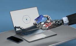 Ein Roboter, der das on-line-Einkaufen mit einer Kreditkarte tut Stockfotos