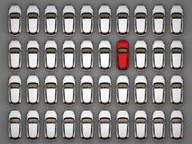 Ein rotes Auto unter vielen weißen Autos lizenzfreie abbildung