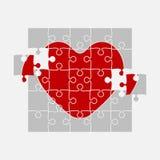 Ein rotes Puzzlespiel-Herz Zackige Liebe medizinisch Stockfoto