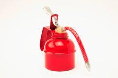 Ein rotes Schmieröl kann auf einer weißen Oberfläche Lizenzfreie Stockfotos