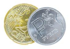 Ein russischer Rubel und 20 Eurocents Stockfotografie