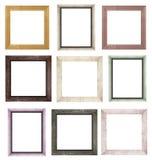 Ein Satz braune Holzrahmen für Bilder und Fotos lokalisiert auf weißem Hintergrund Lizenzfreies Stockbild