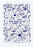 Ein Satz grafische Pfeile von Hand gezeichnet auf Notizbuchblatt Lizenzfreies Stockfoto