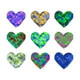 Ein Satz von 9 mehrfarbigen polygonalen Herzen Vektorillustration auf lokalisiertem Hintergrund Stockbild