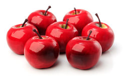 Ein Satz von sieben roten Plastikäpfeln lizenzfreies stockbild