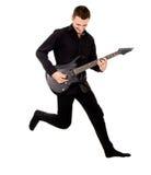 Ein schöner Junge mit E-Gitarre, Sprünge stockbild