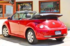 Ein schönes rotes Auto Volkswagen Lizenzfreies Stockbild