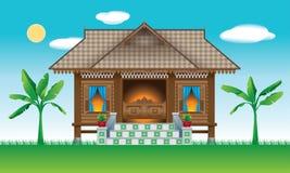 Ein schönes traditionelles hölzernes malaysisches Artdorfhaus stockbilder
