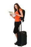Ein Schönheitstourist mit einem Gepäck der Karte in der Hand an lokalisiert Stockfotografie