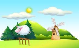 Ein Schaf, das am Zaun mit einer Windmühle an der Rückseite springt Lizenzfreie Stockbilder