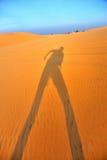 Ein Schatten auf dem Sand Stockfotografie