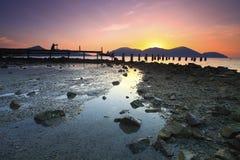 Ein Schattenbild des Fotografen ein Foto des verlassenen fishe machend Lizenzfreie Stockfotos