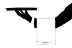 Ein Schattenbild einer Hand, die ein Tellersegment anhält lizenzfreie stockfotografie