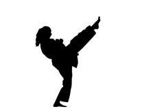 Ein Schattenbild einer Karatefrau Stockfoto