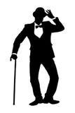 Ein Schattenbild eines Mannes, der einen Stock und ein Gestikulieren anhält stockbild