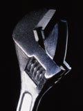 Ein Schlüssel auf einem schwarzen Hintergrund Lizenzfreie Stockbilder