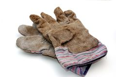Ein schmutziges, benutztes Paar workd Handschuhe lizenzfreie stockbilder