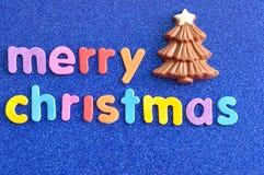 Ein Schokolade Weihnachtsbaum mit den Wörter frohen Weihnachten Lizenzfreie Stockbilder