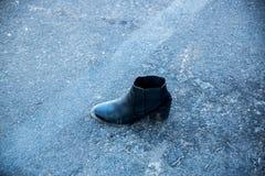 Ein Schuh überlebt ein Massaker Lizenzfreie Stockbilder