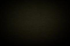Ein schwarzer Auslegungpappbeschaffenheitshintergrund. Stockfotografie