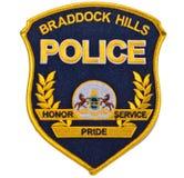 Ein Schwarzes und Gold-BRADDOCK HÜGEL ÜBERWACHEN Schulterflecken auf einem weißen Hintergrund polizeilich lizenzfreies stockfoto