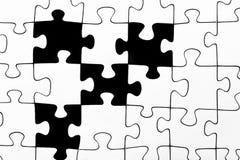 Ein Schwarzweiss-Spannvorrichtungssägepuzzlespiel Lizenzfreie Stockfotografie