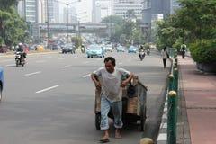 Ein Scrip Abgassammler-Mann stockfotografie