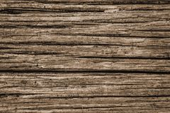 Ein Sepia Tone Rustic Background aus verwittertem Holz heraus lizenzfreies stockfoto