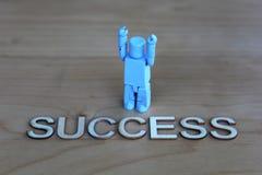 Ein Sieger mit dem Wort Erfolg Stockfotos