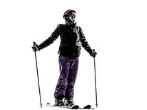 Ein Ski fahrendes glückliches lächelndes Schattenbild des Frauenskifahrers Stockbild