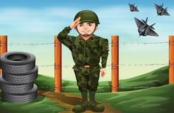 Ein Soldat vor dem barbwire Zaun lizenzfreie abbildung