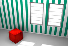 Roter Würfel in einem Raum mit grüner Streifen-Tapete Stockfotos
