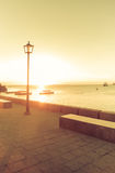 Ein Sonnenaufgang durch das Meer Stockbilder
