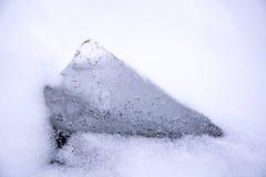Ein Stück Eis an der Wintersaison Stockbilder
