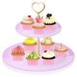 Ein Stand des kleinen Kuchens mit kleinen Kuchen Lizenzfreies Stockfoto