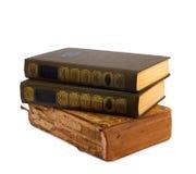 Ein Stapel alte Bücher mit Golddem stempeln Lizenzfreie Stockfotografie