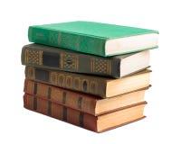 Ein Stapel alte Bücher mit Golddem stempeln Stockbilder