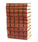 Ein Stapel alte Bücher mit Golddem stempeln Lizenzfreie Stockfotos