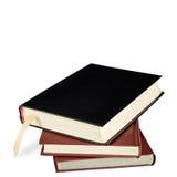 Ein Stapel von drei Büchern mit Bookmark Stockfotografie